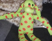 Green and Red polka dotted sock dog