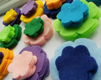 120 pieces of felt flower die cut out pieces- 2 shapes, 6 of each, in 10 colors.  Rainbow summer neon skittles colors