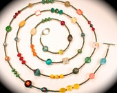 Long forty-eight inch beaded necklace with sterling Bali beads, vintage, filigree, turquoise, and crystal beads.