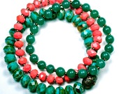 Beautiful variation of three sets of Czech rondelle stretch bracelets in turquoise, coral, and green.