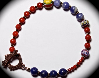 Beaded bracelet with lapis, trade beads, assorted beads and brass toggle.