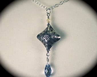 Hill Tribe Silver pendant with faceted Swarovski crystal.
