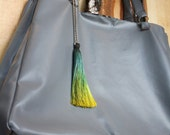 Gray faux leather large tote bag with tassel