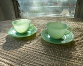 Beautiful vintage Fire King Jane Ray jadeite jadite cups and saucers set of two.