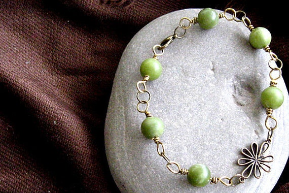 Bracelet with Olive Serpentine beads wire wrapped in brass, artisan flower component in center