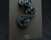 Movable gears on rusted metal stand