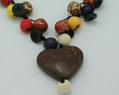 Young Hearts Run Free necklace made with wooden beads and coconut heart pendant.