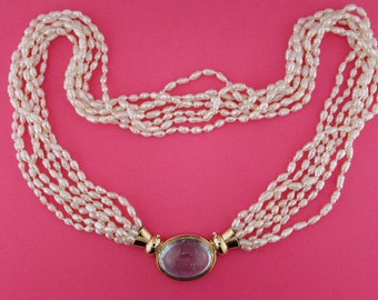 Seven strand Chinese freshwater rice pearl necklace with detachable Aquamarine clasp.