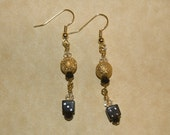 Gold bead and black dice earrings