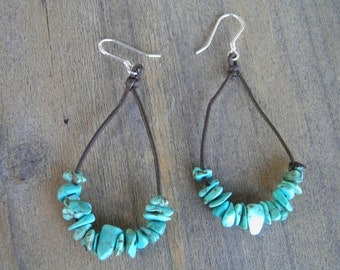 "Earrings... ""Hanging on"" Turquoise strung on brown leather cord with sterling silver ear wires."