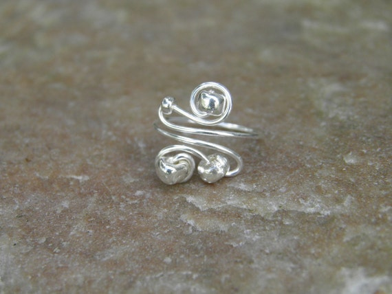"""Toe ring... """"Silver Lining"""" silver wire wrapped toe ring with silver glass beads."""