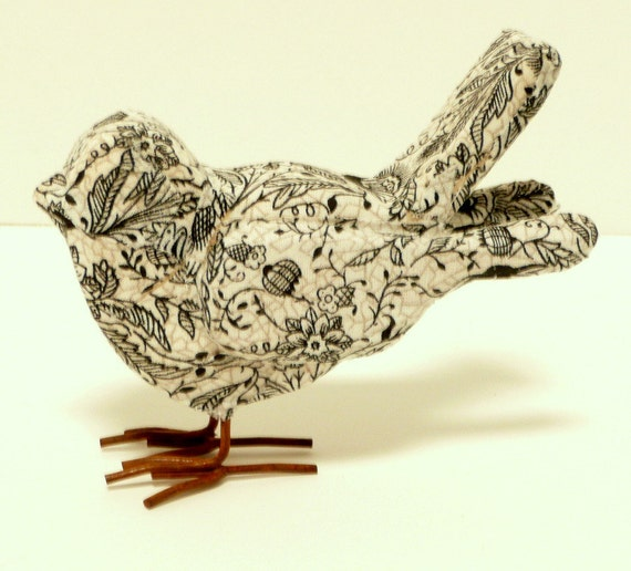 Black and white fabric covered bird