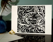 "Hand printed ""Wren in the Hedge"" in black card"