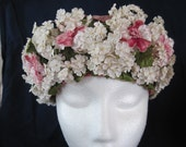 Easter bonnet with lots of flowers and crowned in velvet leaves