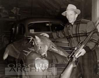 THE DEER HUNTER - a proud man poses with a dead deer laying across the car hood - Circa 1950 Photograph