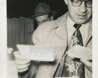MAN WITH PICTURES - a private eye watches as a man gets some bad news.... 1950's snapshot photograph