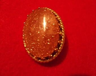 Goldstone Brooch