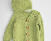 Hand knitted green newborn baby hat and cardigan
