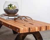 reclaimed wood bolted slab coffee table.  custom height, local delivery