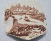 Old ceramic pottery boat bridge scene sea glass