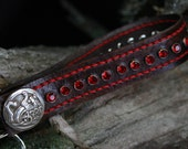 Wristlet/keychain featuring red crystals and celtic dragon concho