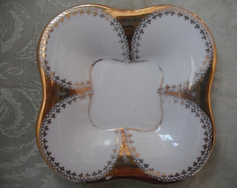 small  vintage china dish with intricate gold trim  ECS