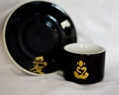 Set of four stackable Buddha Expresso cups and saucers