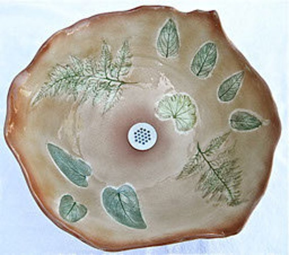 First Autumn Vessel Sink in medium brown features sage,fern and geranium leaf imprints and a sculptural rim.
