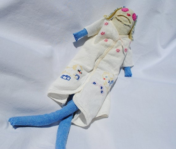 sock animal made with antique baby clothes, hand stitched, made with all recycled materials