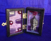 Buddhist Small Shrine Altar Box Purple, Red And Black With Metal Buddha Or Bodhisattva, Glass, Ribbon, And Paper