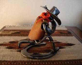 Cowboy praying sculpture