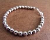Round Silver Beaded Bracelet
