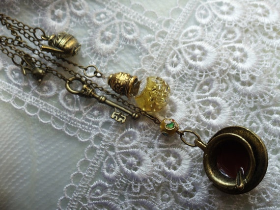 """Alice in Wonderland necklace, tea party necklace,  24""""  holds tea party charms and potions"""