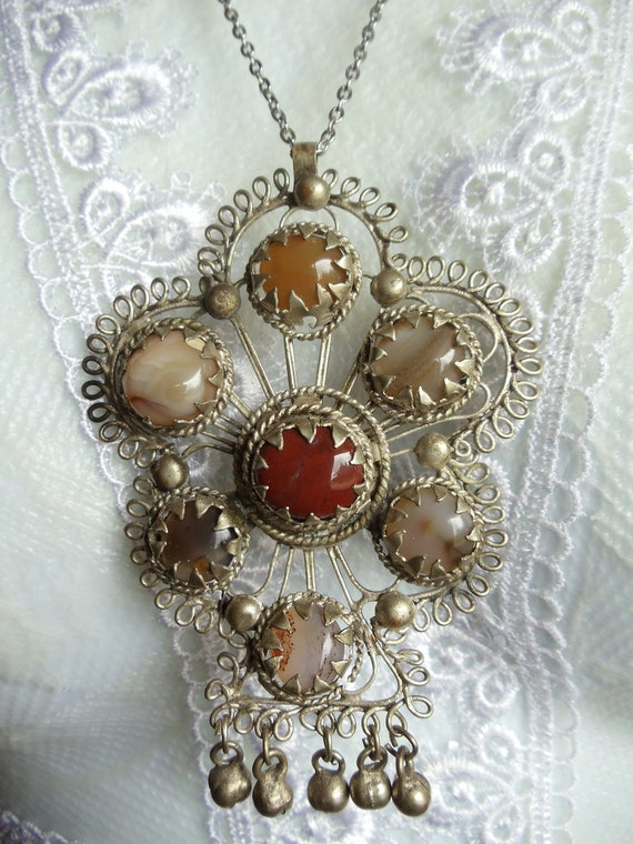 Vintage necklace with silver filigree and polished agate stones as settings