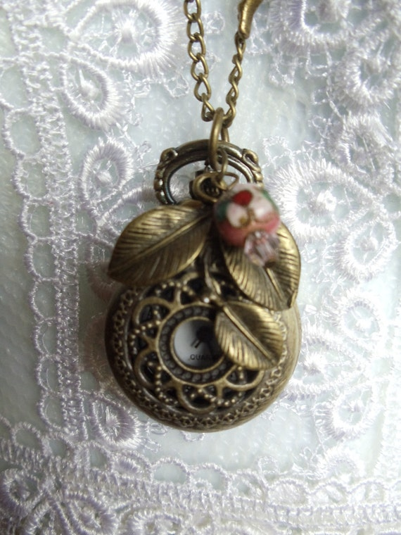 Fairy pocket watch pendant, Watch pendant, Fairy pocket watch adorned with Czech and Swarovski crystal and antique bronze charms