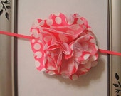 """Pink satin puff flower with large white polka dots attached to a skinny pink 1/8"""" headband."""