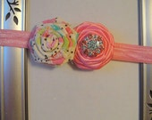 """Beautiful pink satin rosette with cotton summer them rosette attached to a matching pink 5/8"""" headband."""