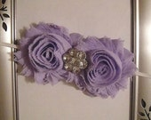 """Purple shabby flowers with gemstone center attached to a white skinny 1/8"""" headband."""