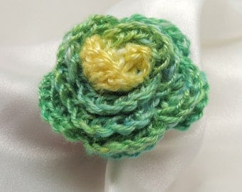 Green and Yellow Crocheted Rosette