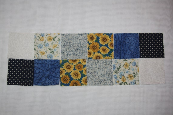 60 squares, 2 1/2 inches, 10 each of 6 patterns, whites, blues, yellows