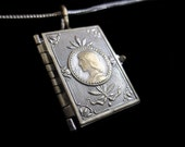 Victorian Silver Book Locket w Joan 0f Arc on Front And A Sword & Crown on the Reverse