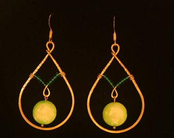 Brass wire wrapped hoop earrings with lime green mother of pearl beads