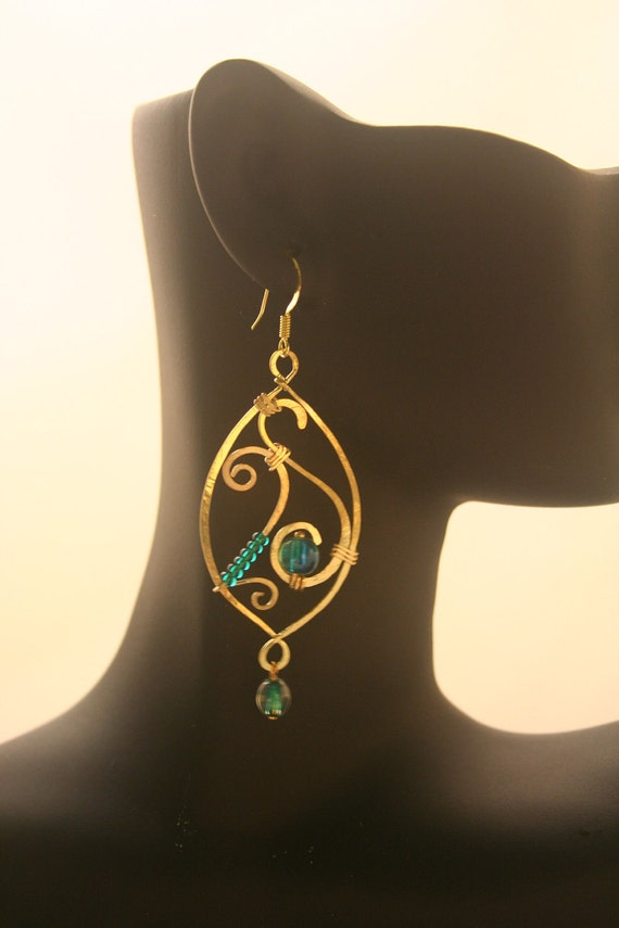 Brass eliptic wire-wrapped earrings with teal glass beads