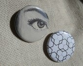 "Set of two 1.25"" pinback buttons - Looks Like -"