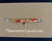 Valentine's Day Bracelet handmade in Uk with Liberty fabric, Eiffel tower and rose charms