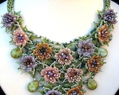 Beaded flower necklace in purple, pink, orange and green