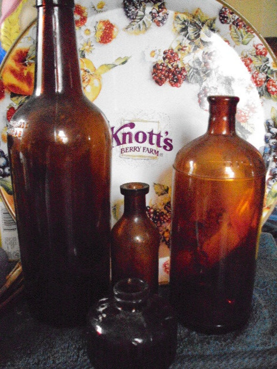 vintage/collectables amber glass bottles from the presidentspalace