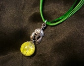 Fried Yellow Marble Warrior Helmet Chain Charm on Green Necklace