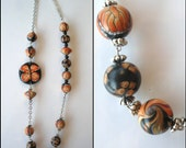Necklace with orange butterflies black beads from polymer clay fimo handmade