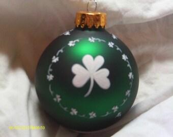 Handpainted shamrock on a Christmas ball